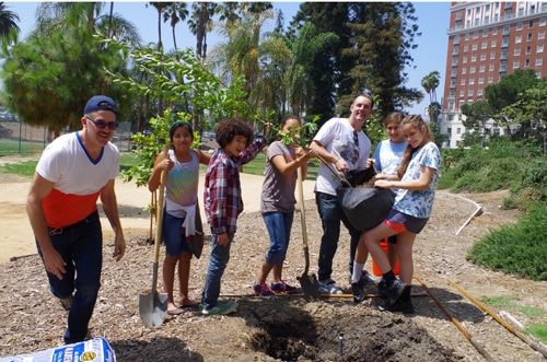 Fallen Fruit planting trees with the kids from Heart of Los Angeles, HOLA
